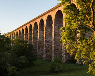 Early light highlighting the arches of Crimple Viaduct