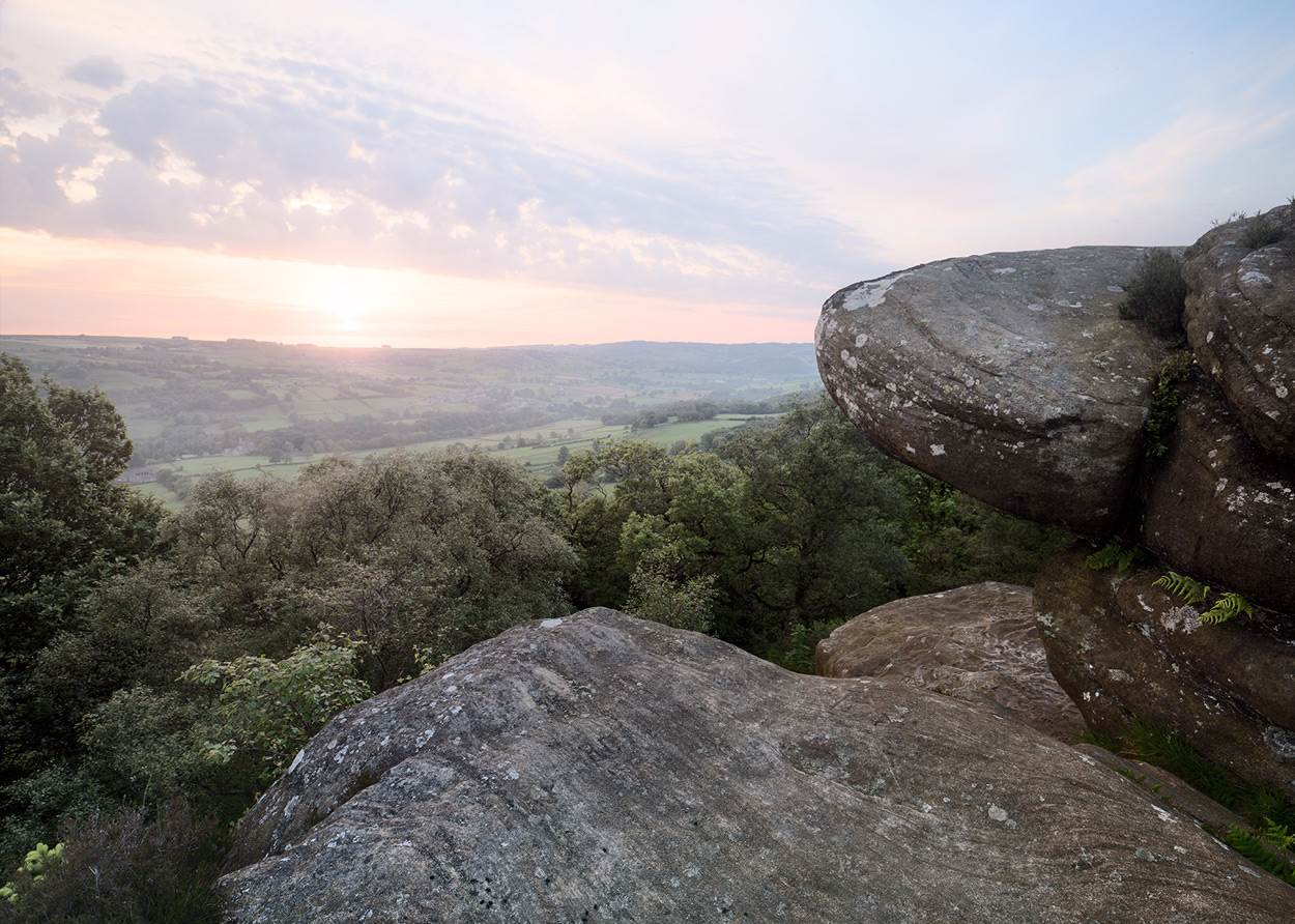 Rocky outcrop looking over the Nidd Valley on a summer dawn